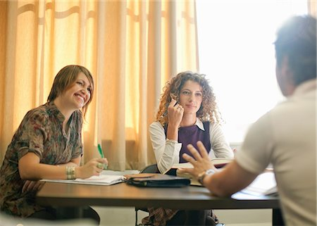 partnership - Students studying together at desk Stock Photo - Premium Royalty-Free, Code: 614-06623364