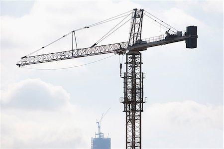 Silhouette of crane in blue sky Stock Photo - Premium Royalty-Free, Code: 614-06623366