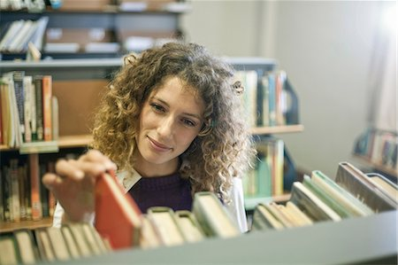 student (female) - Student searching for book in library Stock Photo - Premium Royalty-Free, Code: 614-06623388