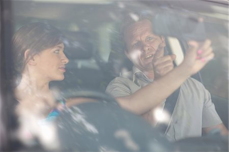 practise - Father teaching teenage daughter driving Stock Photo - Premium Royalty-Free, Code: 614-06623405