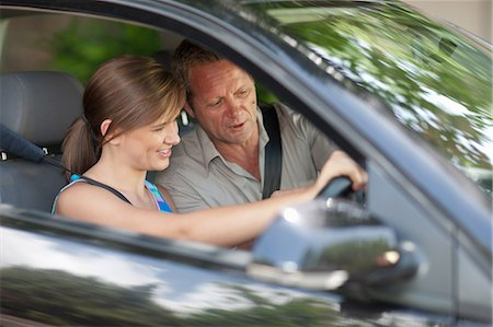 practise - Father teaching teenage daughter driving Stock Photo - Premium Royalty-Free, Code: 614-06623403