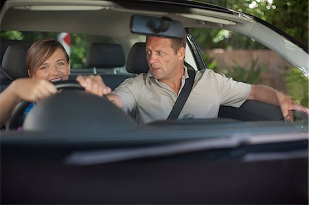 practise - Father teaching teenage daughter driving Stock Photo - Premium Royalty-Free, Code: 614-06623416