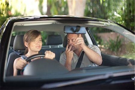 front - Father teaching teenage daughter driving Stock Photo - Premium Royalty-Free, Code: 614-06623420