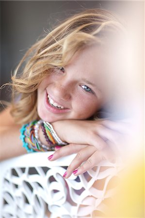 preteen beauty - Smiling girl resting chin on bench Stock Photo - Premium Royalty-Free, Code: 614-06623434