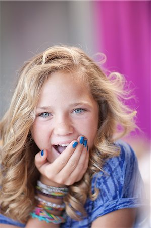preteen  smile  one  alone - Girl gasping with hand over mouth Stock Photo - Premium Royalty-Free, Code: 614-06623435