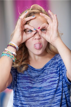 funny pose - Smiling girl making face Stock Photo - Premium Royalty-Free, Code: 614-06623430