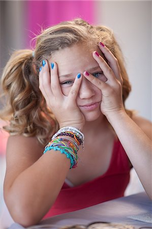 preteen girl pigtails - Frustrated girl with head in hands Stock Photo - Premium Royalty-Free, Code: 614-06623440