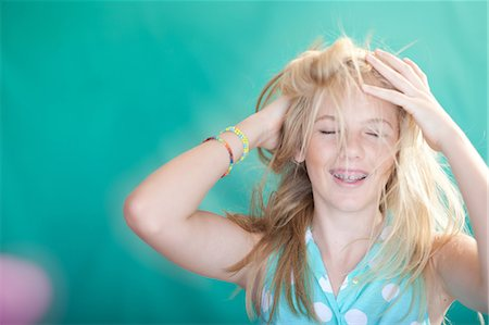 preteen open mouth - Teenage girl tossing her hair Stock Photo - Premium Royalty-Free, Code: 614-06623451