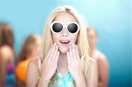surprised - Teenage girl in sunglasses gasping Stock Photo - Premium Royalty-Free, Code: 614-06623484
