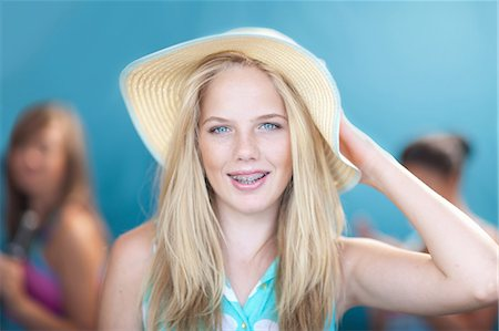 preteen open mouth - Teenage girl wearing floppy hat Stock Photo - Premium Royalty-Free, Code: 614-06623481