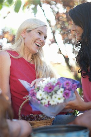 Daughter giving mother flowers Stock Photo - Premium Royalty-Free, Code: 614-06623495