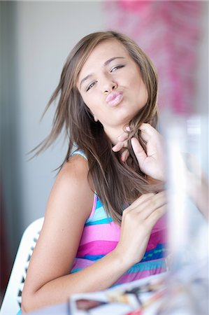 pucker - Teenage girl making kissy face Stock Photo - Premium Royalty-Free, Code: 614-06623510