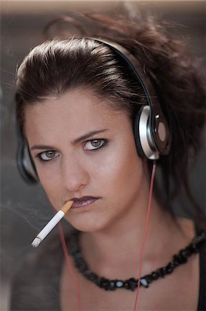 smoke - Teenage girl in dark makeup smoking Stock Photo - Premium Royalty-Free, Code: 614-06623596