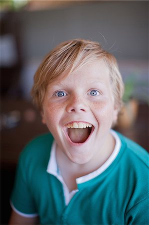 preteen open mouth - Close up of boy's smiling face Stock Photo - Premium Royalty-Free, Code: 614-06623659