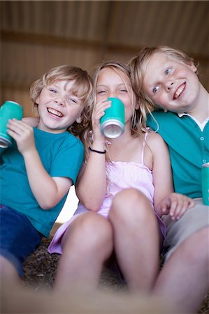 Children drinking soda in garage Stock Photo - Premium Royalty-Free, Code: 614-06623653