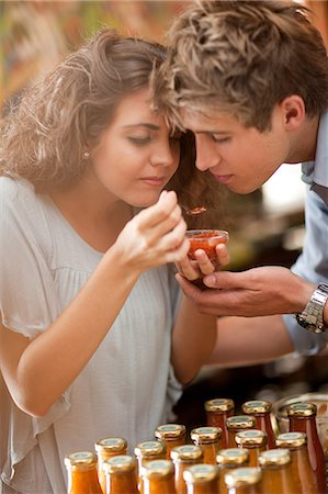 smelling - Couple tasting preserves in grocery Stock Photo - Premium Royalty-Free, Code: 614-06623814