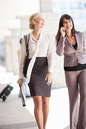 Businesswomen walking together Stock Photo - Premium Royalty-Free, Code: 614-06623834