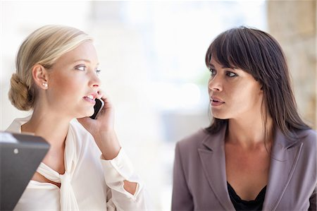 Businesswomen standing outdoors Stock Photo - Premium Royalty-Free, Code: 614-06623836