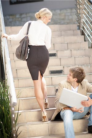 flirting - Business people greeting on steps Stock Photo - Premium Royalty-Free, Code: 614-06623849