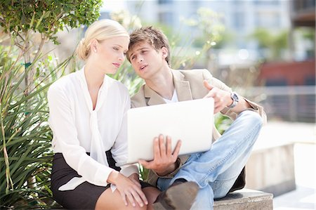 Business people using laptop outdoors Stock Photo - Premium Royalty-Free, Code: 614-06623857