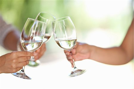 Friends toasting with wine outdoors Stock Photo - Premium Royalty-Free, Code: 614-06623884
