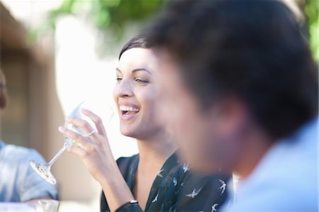 Friends having drinks at table outdoors Stock Photo - Premium Royalty-Free, Code: 614-06623988