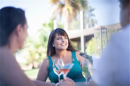 friendship - Friends having drinks at table outdoors Stock Photo - Premium Royalty-Free, Code: 614-06623994