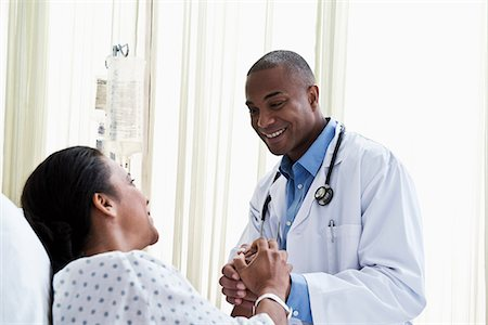 doctor and patient - Doctor holding hands with patient Stock Photo - Premium Royalty-Free, Code: 614-06718045