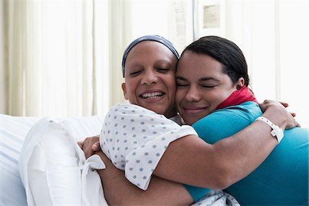 Daughter hugging mother at hospital Stock Photo - Premium Royalty-Free, Code: 614-06718040