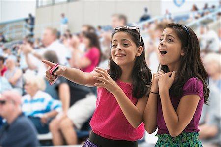 Adoring girls at pop concert Stock Photo - Premium Royalty-Free, Code: 614-06718156