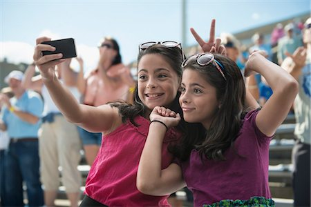Girls taking a picture of themselves at pop concert Stock Photo - Premium Royalty-Free, Code: 614-06718151