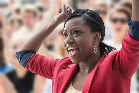 Excited woman in crowd Stock Photo - Premium Royalty-Free, Code: 614-06718202