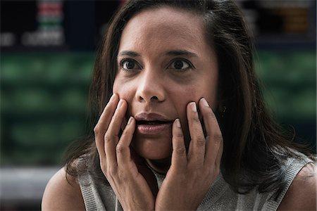 people in panic - Shocked businesswoman at stock exchange Stock Photo - Premium Royalty-Free, Code: 614-06718212