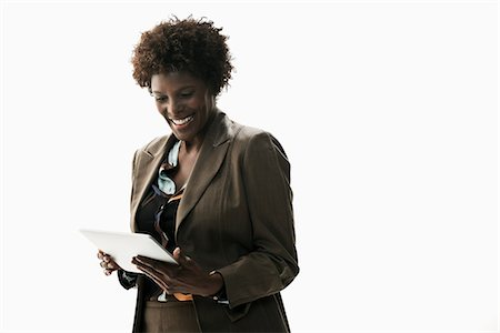 Businesswoman holding digital tablet Stock Photo - Premium Royalty-Free, Code: 614-06718226