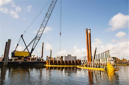 Crane at construction site on water Stock Photo - Premium Royalty-Free, Code: 614-06718256