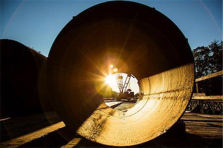 Sunrise viewed through concrete pipe Stock Photo - Premium Royalty-Free, Code: 614-06718274