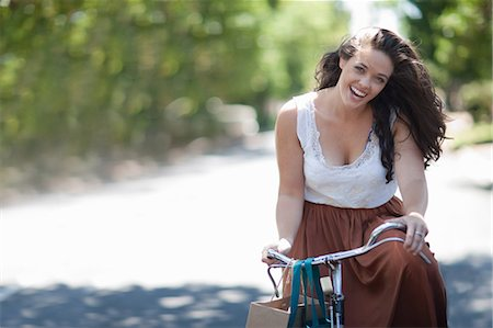 Woman riding bicycle in park Stock Photo - Premium Royalty-Free, Code: 614-06718277