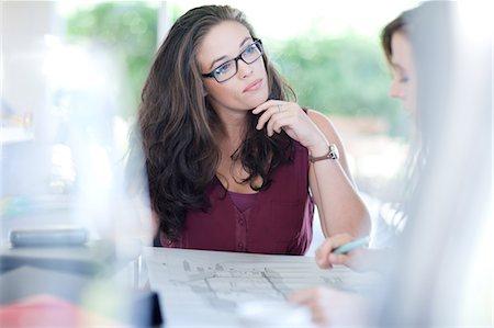 Businesswomen talking in meeting Stock Photo - Premium Royalty-Free, Code: 614-06718294