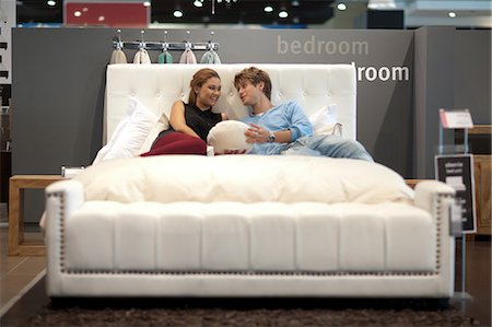 Couple shopping for mattress in store Stock Photo - Premium Royalty-Free, Code: 614-06718399