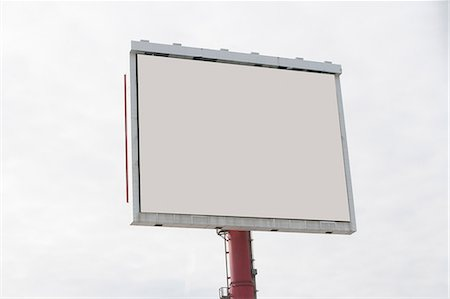 Blank billboard in cloudy sky Stock Photo - Premium Royalty-Free, Code: 614-06718457