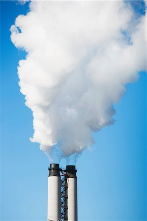 smoke - Smoke billowing from industrial plant Stock Photo - Premium Royalty-Free, Code: 614-06718554