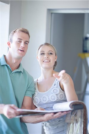 Couple discussing home renovations Stock Photo - Premium Royalty-Free, Code: 614-06718654