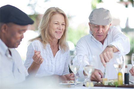 Older friends eating together outdoors Stock Photo - Premium Royalty-Free, Code: 614-06718709