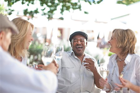 Older friends having wine together Stock Photo - Premium Royalty-Free, Code: 614-06718717