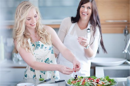 Women cooking together in kitchen Stock Photo - Premium Royalty-Free, Code: 614-06718794