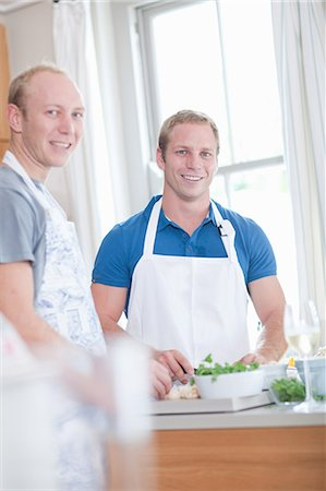 Men cooking together in kitchen Stock Photo - Premium Royalty-Free, Code: 614-06718816