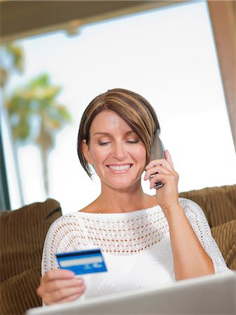 person on phone with credit card - Woman shopping on telephone Stock Photo - Premium Royalty-Free, Code: 614-06718885