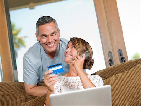 person on phone with credit card - Couple shopping on telephone Stock Photo - Premium Royalty-Free, Code: 614-06718886