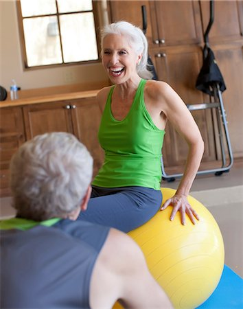 Older couple working out at home Stock Photo - Premium Royalty-Free, Code: 614-06718931