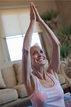 Older woman practicing yoga at home Stock Photo - Premium Royalty-Free, Code: 614-06718990